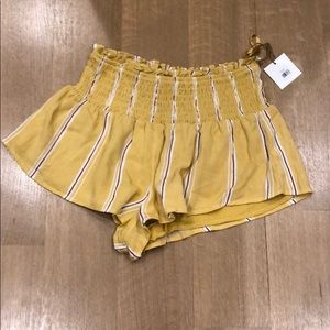 Yellow and purple flowy shorts